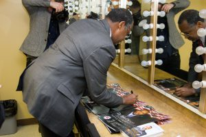 Dr. Ben Carson signs a poster designed by Cool Jazz Web Design and Marketing in Danville, KY